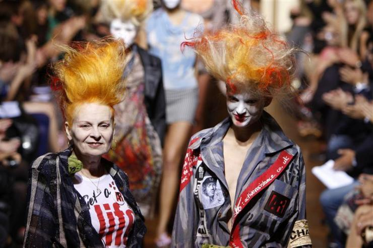 British designer Vivienne Westwood arrives at the end of her Spring/Summer 2010 collection in Paris